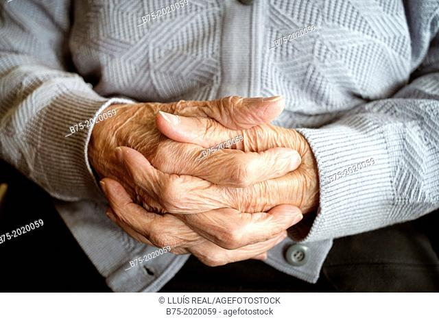 Close up of the hands of a centennial woman in a elderly people home