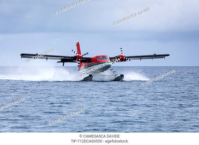 Maldives, Ari Atoll, Moofushi Resort, A Trans Maldivian seaplane landing in the water of the Constance Moofushi Resort