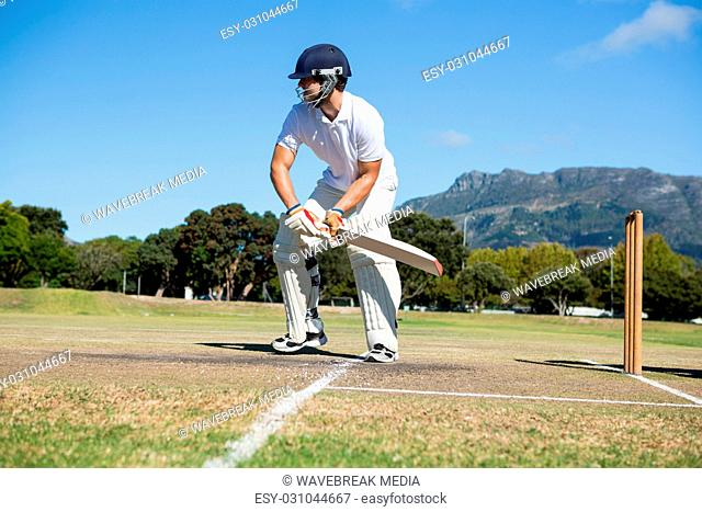 Player batting at field against clear sky