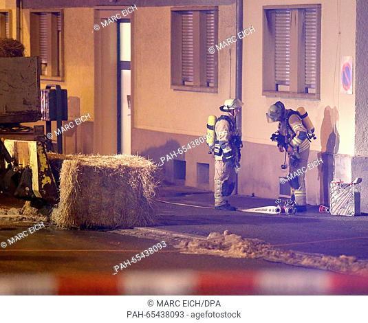 Police forces cordon off a crime scene on a street in front of a refugee shelter in Villingen-Schwenningen, Germany, 29 January 2016