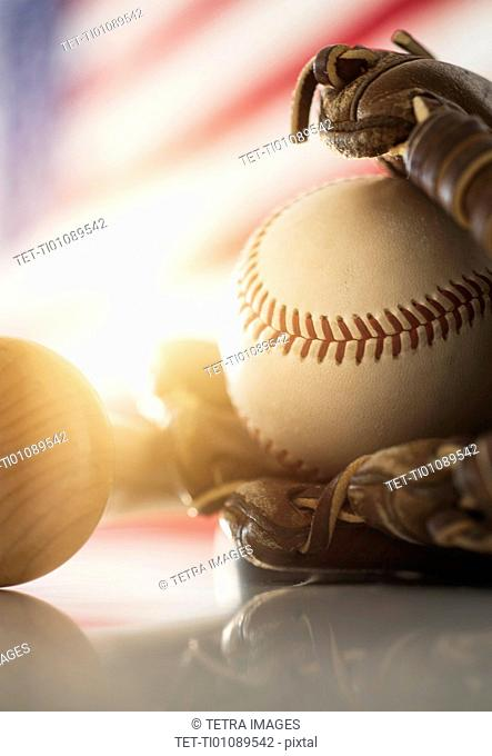 Close-up of baseball glove, ball and bat