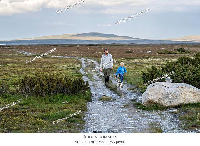 Father hiking with son
