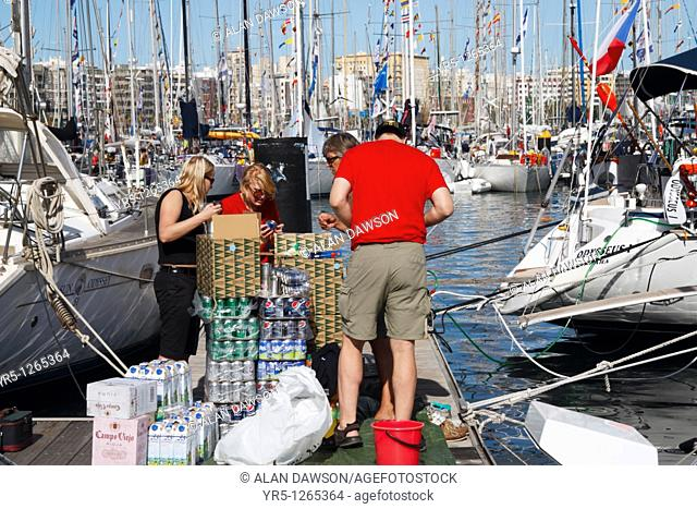 Yacht crew taking delivery of food supplies in preparation for the anual ARC transatlantic race from Las Palmas, Gran Canaria to St Lucia in the Caribbean