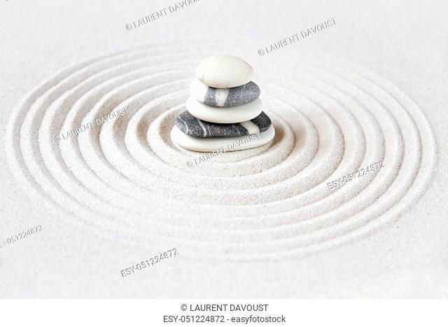 Black and white stones in the sand. Zen japanese garden background scene