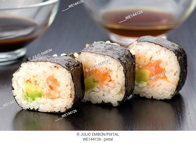 Japanese sushi in classic dark wood base