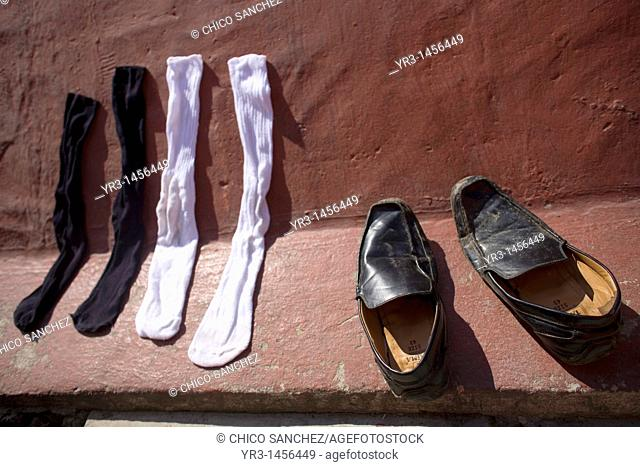 Shoes and socks of an undocumented Central American migrants traveling across Mexico to work in the United States dry in the sun at a shelter for migrants...