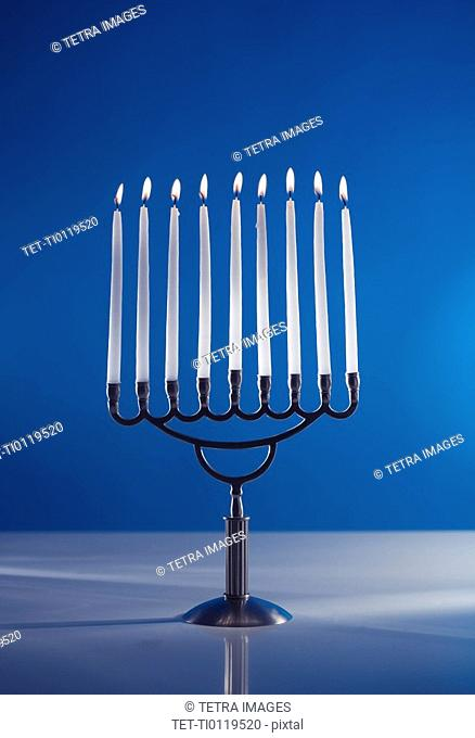 A fully lit menorah