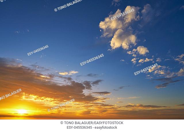 Sunrise or sunset sky with clouds in blue and orange
