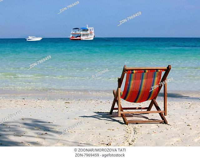 Lonely chaise lounge on a beach