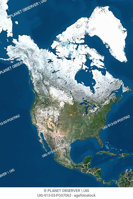 Satellite view of North America in winter, with partial snow cover (with country boundaries). This image was compiled from data acquired by Landsat 7 & 8...