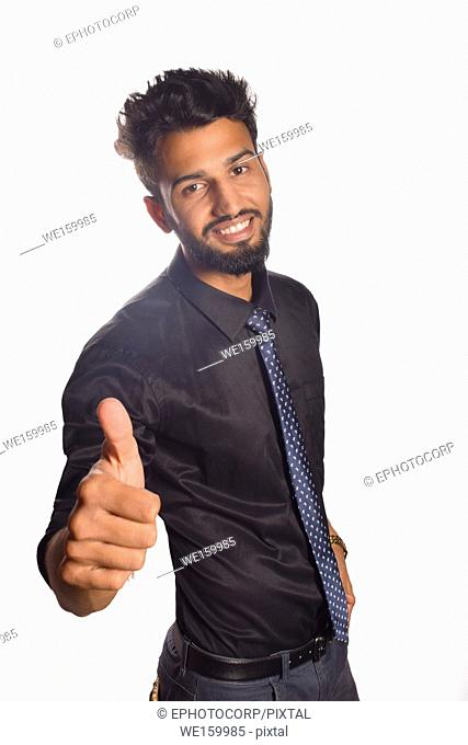 Young male model saying OK with thumb, Pune, Maharashtra