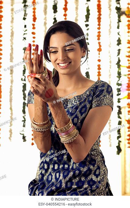 Indian bride wearing bangles
