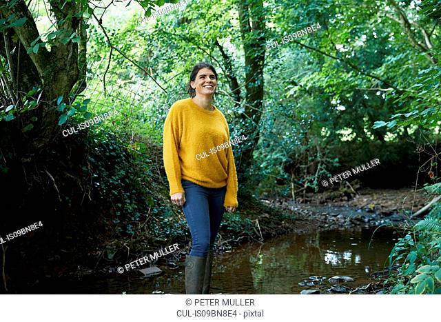 Hiker standing in stream