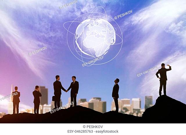 Businesspeople silhouettes on abstract city background with glowing digital globe. Meeting and international business concept