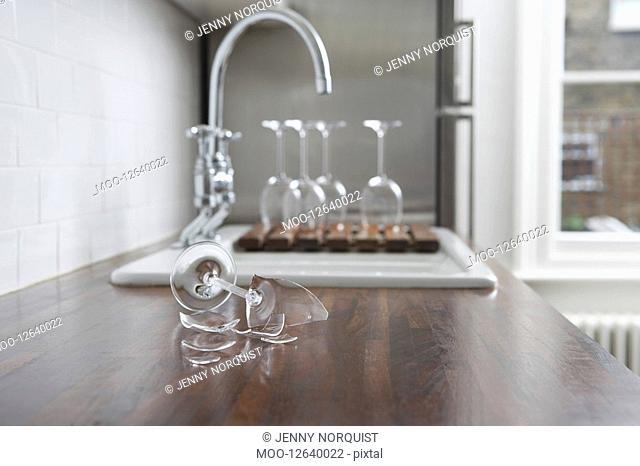 Broken wine glass on kitchen counter