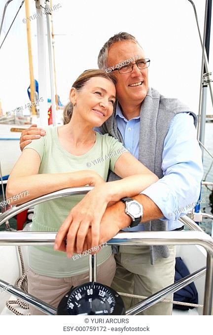 Cute senior couple enjoying a sea voyage together