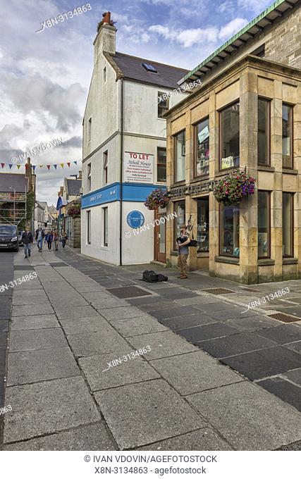 Bagpipe player, Kirkwall, Mainland, Orkney islands, Scotland, UK