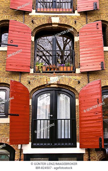 Windows with red shutters on Brouwersgracht, Amsterdam, Netherlands, Europe