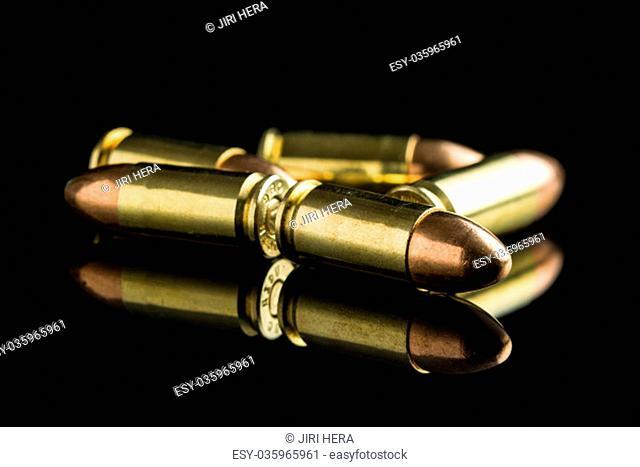 9mm pistol bullets on black table