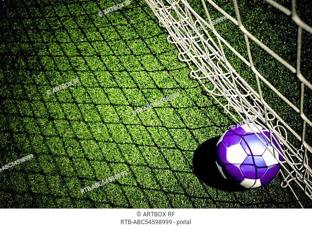 Close-up of a soccer ball at goal post