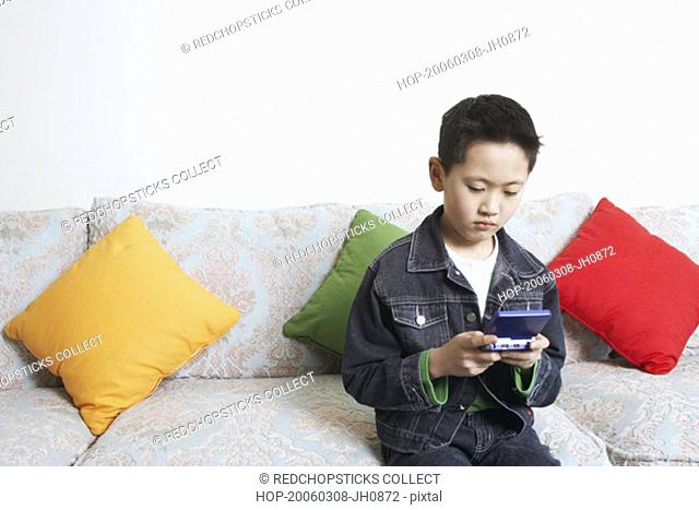 Close-up of a boy playing a video game