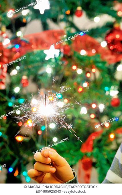Christmas party sparkler on background of lights