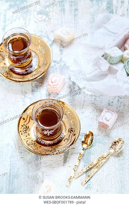 Two glasses of Turkish black tea and sweets