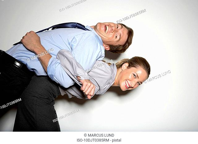 Woman lifting man on back