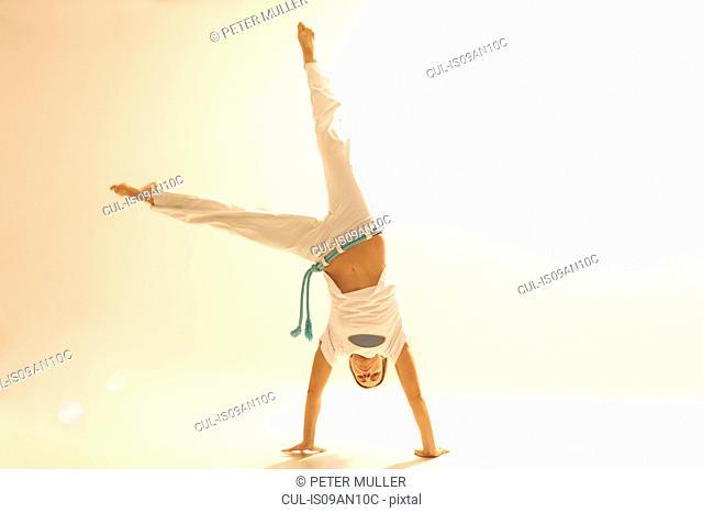 Woman practising capoeira