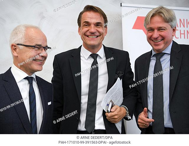 Heinrich Riethmoller (left to right), head of the German Publishers and Booksellers Association, Juergen Boos, the Fair's director, and Markus Dohle