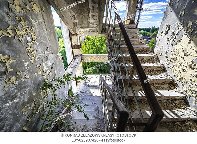 Staircase of abandoned Jupiter Factory in Pripyat ghost town of Chernobyl Nuclear Power Plant Zone of Alienation in Ukraine
