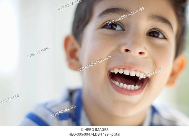 close up of elementary aged boy looking excited