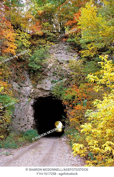 Tunnel in Rocheport Missouri with light beyond on the Rails to Trails project, Missouri USA