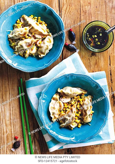 Pork dumplings with corn and ginger stir-fry