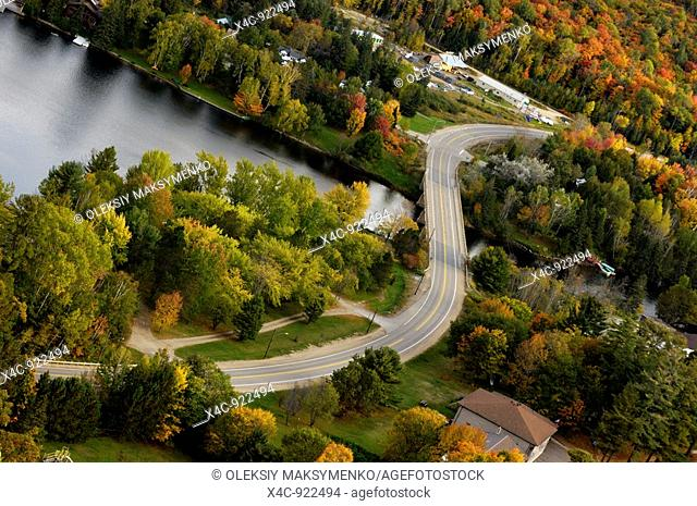 S-curve of a winding country road in fall  Muskoka region Dorset, Ontario, Canada