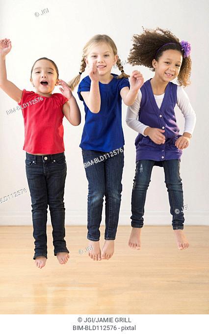 Girls jumping for joy together