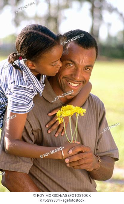 Daughter gives dad a flower
