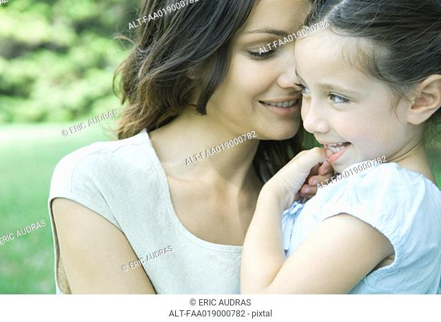 Girl and mother, smiling, portrait