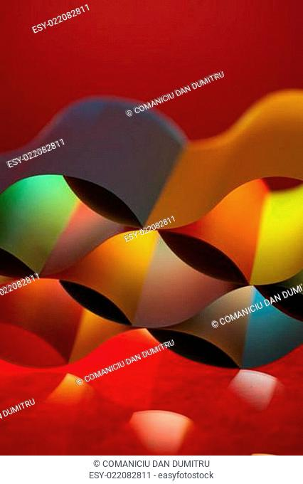 abstract colored paper structure on red background