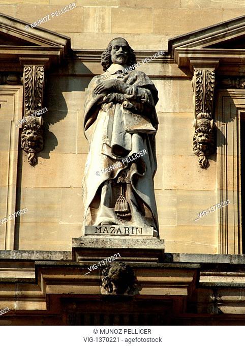 FRANCE, PARIS, 01.05.2007, Statue of Giulio Raimondo Mazzarino, better known as Cardinal Jules MAZARIN at the facade of The Louvre Museum - Palais Royal