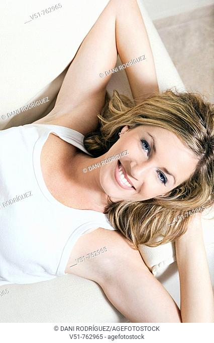 Woman laying on the couch smiling