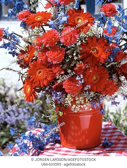 Mixed red Flowers in a bucket