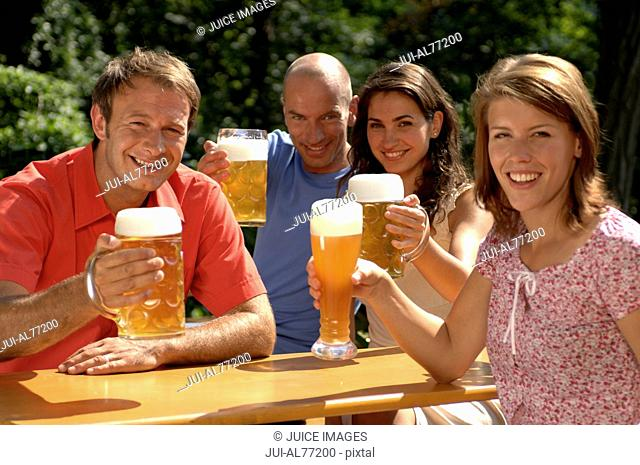 Portrait of two couples drinking beer, beergarden, Munich, Bavaria, Germany