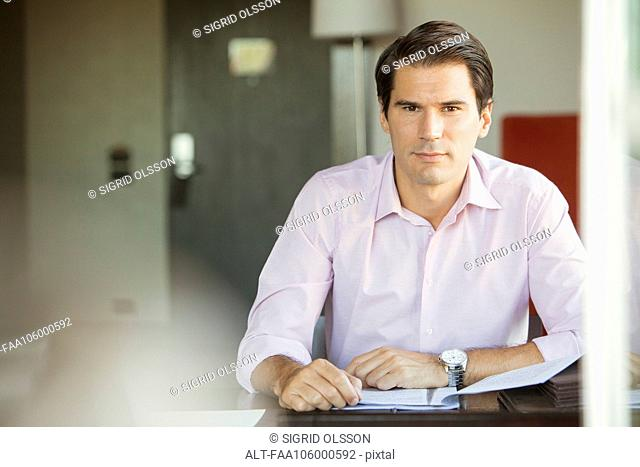 Businessman in office, portrait