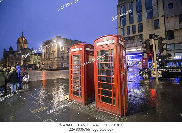 The Royal Mile by dusk Edimburgh old town. Scotland, UK. Red telephone booths
