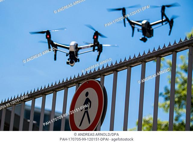 Two drones in flight during a demonstration in Langen, Germany, 5 July 2017. The German Air Navigation Service (DFS) hosted an event providing information on...