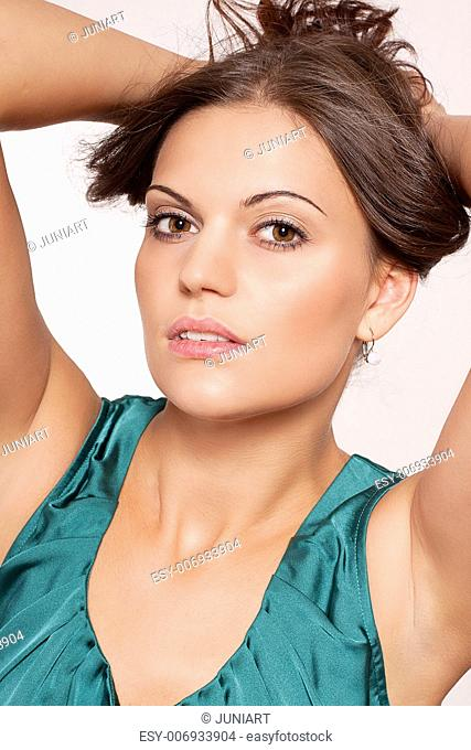 beautiful brunette woman portrait with makeup and brown eyes