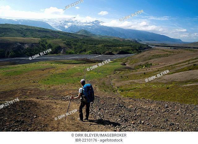 Female hiker admiring the view of the Eyjafjallajoekull volcano and the Þroengá, Throenga glacial river, Laugavegur hiking trail, Emstrur-Þórsmoerk, Thorsmoerk