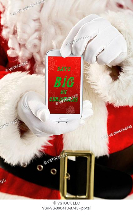 Mid section of Santa holding cell phone