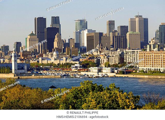 Canada, Quebec, Montreal, Old Montreal and the skyscrapers of downtown from the banks of the St. Lawrence River